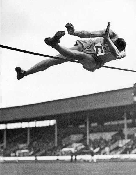 Exertion Wall Art - Photograph - Winning High Jumper by Underwood Archives