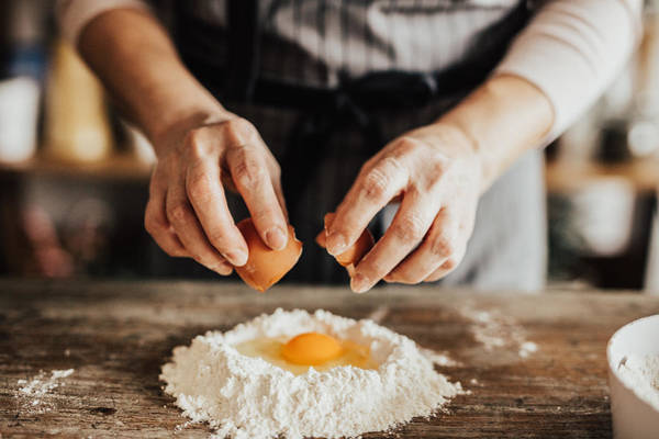 Woman Adds An Egg To The Flour Art Print by Anchiy