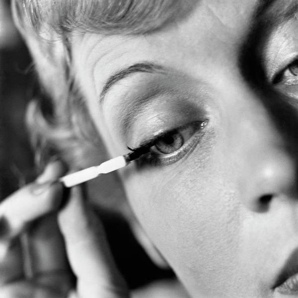 Woman Applying Mascara Art Print