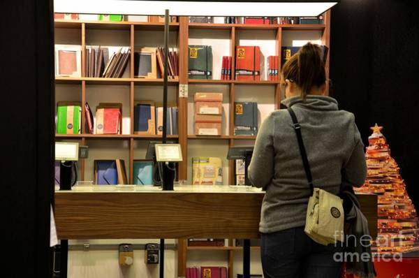 E-reader Wall Art - Photograph - Woman Browses Kindle And Books At Bookshop by Imran Ahmed