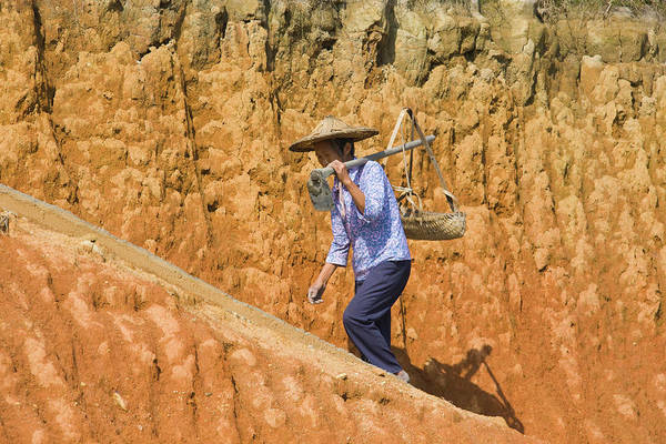 Wall Art - Photograph - Woman Carrying Basket On Clay Hill by Keren Su