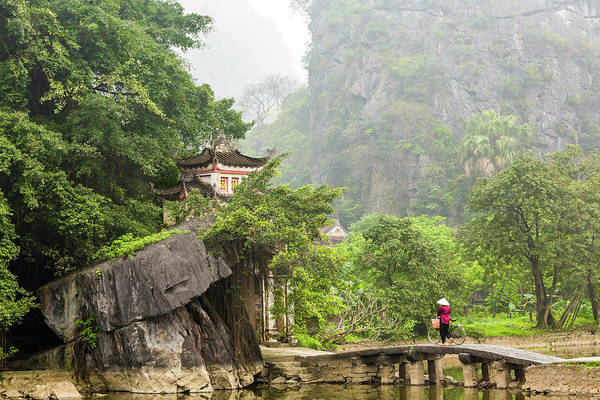 Bicycle Photograph - Woman Crossing Bridge To Temple, Ninh by Peter Adams