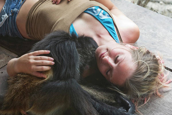Quintana Roo Photograph - Woman Cuddles With Monkey In Mexico by Patrick Orton