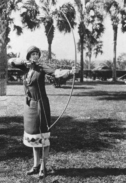 Archery Photograph - Woman Demonstrates A Longbow by Underwood Archives