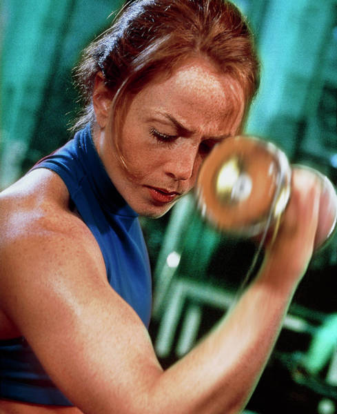 Woman Does Arm Curling Exercise With A Dumb-bell Art Print