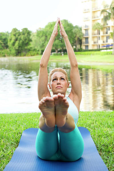 Wall Art - Photograph - Woman Doing Yoga And Pilates Exercises by Leslie Parrott