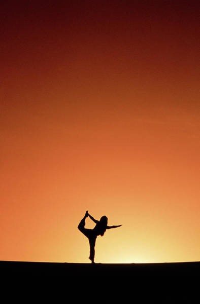 Spiritual Bliss Wall Art - Photograph - Woman Doing Yoga At Sunset by Woods Wheatcroft