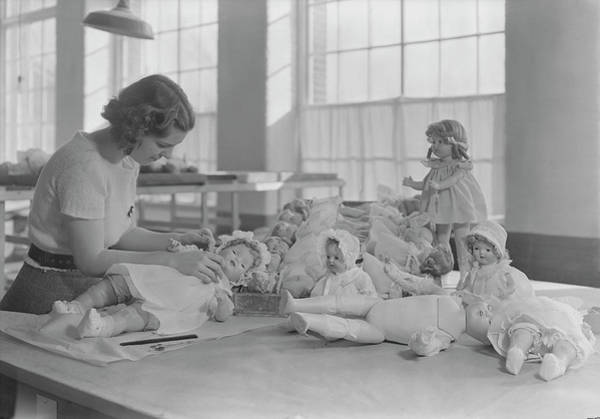 Doll Parts Photograph - Woman Dressing And Packing Dolls, 1936 by Stocktrek Images
