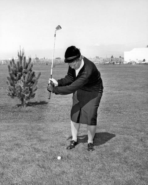 Photograph - Woman Golfer Ready To Swing by Underwood Archives