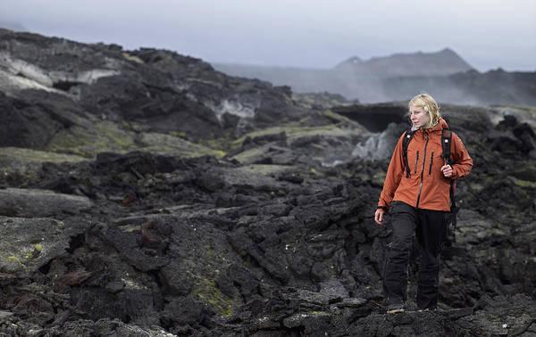 Wall Art - Photograph - Woman Hiking Through Lava Field by Henn Photography