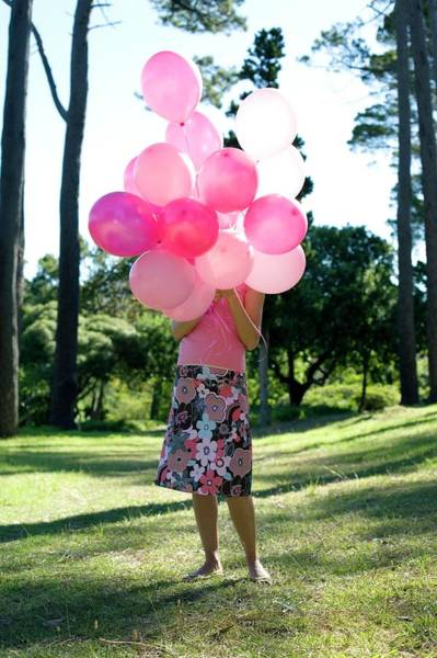 Breast Cancer Awareness Wall Art - Photograph - Woman Holding Balloons by Ian Hooton/science Photo Library