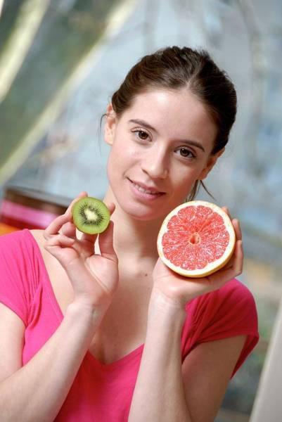 Woman Holding Fruit Art Print