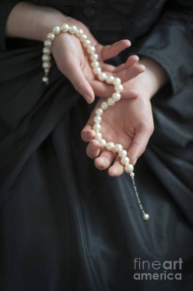 Jewelery Photograph - Woman In Black Holding A String Of Pearls  by Lee Avison