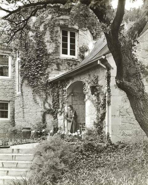 Landscape Architecture Photograph - Woman In Doorway Of House by Peter Nyholm