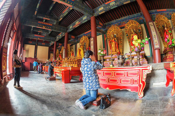 Candid Photograph - Woman In Front Of Altar, Lama Temple by Peter Adams