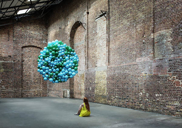 Candid Photograph - Woman In Warehouse With Globe Made Of by Anthony Harvie