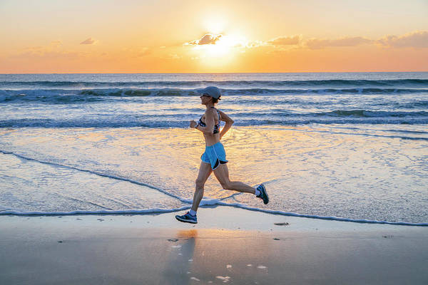 Noosa Wall Art - Photograph - Woman Jogging On Beach At Sunrise by Andrew Peacock