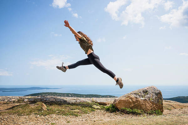 Wall Art - Photograph - Woman Jumping From Rock On Summit by Cate Brown