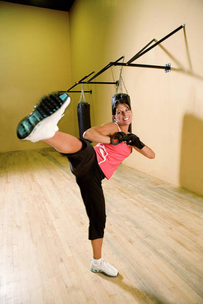 Kickboxing Photograph - Woman Kickboxing In A Gym by Corey Rich
