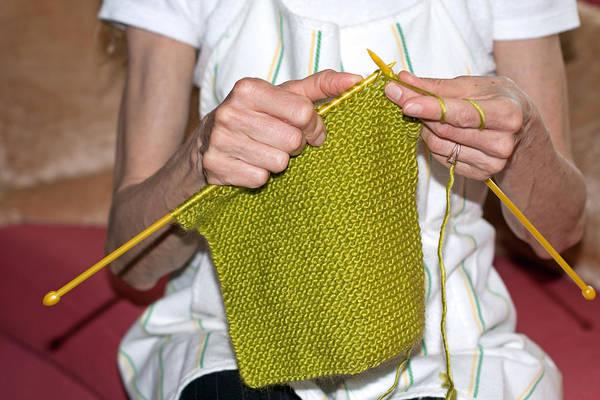 Photograph - Woman Knitting by Gunter Nezhoda