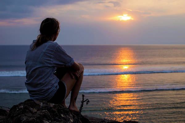 Wall Art - Photograph - Woman Looks At Sunset In The Ocean by Konstantin Trubavin