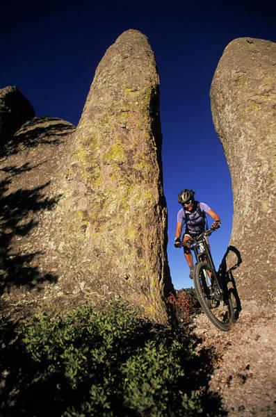 Copper Mountain Photograph - Woman Mountain Biking In Valley by Scott Markewitz