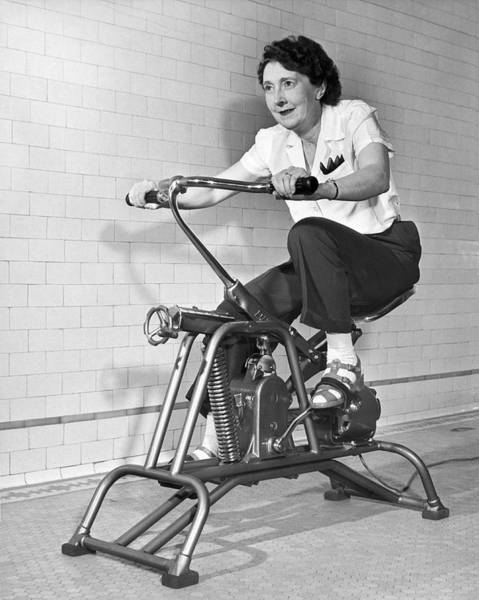 Exertion Wall Art - Photograph - Woman On Exercycle by Underwood Archives