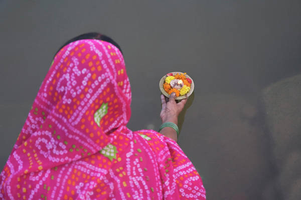 Ganges River Photograph - Woman Putting Flower Lamp Onto by Keren Su