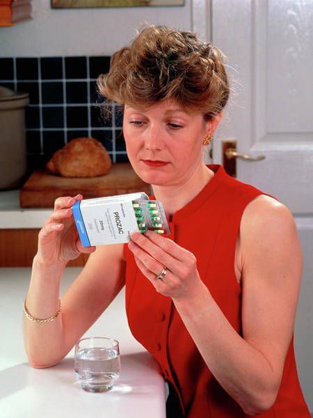 Wall Art - Photograph - Woman Reading Dose Label On Pack Of Prozac Pills by Damien Lovegrove/science Photo Library