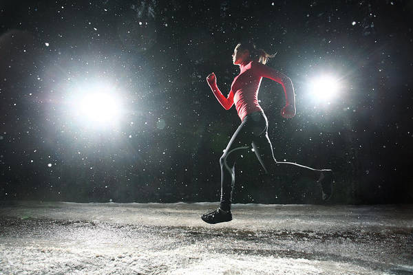 Adolescence Photograph - Woman Running At Night In Snow by Stanislaw Pytel