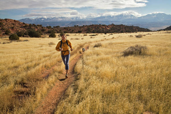 Dog Training Photograph - Woman Running In Field, Moab, Utah by Whit Richardson