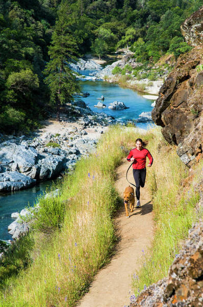 Yuba River Photograph - Woman Runs With Her Dog Along The Yuba by Josh Miller