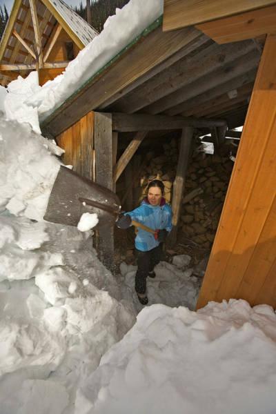 Jasmin Photograph - Woman Shoveling Snow, Canada by Whit Richardson