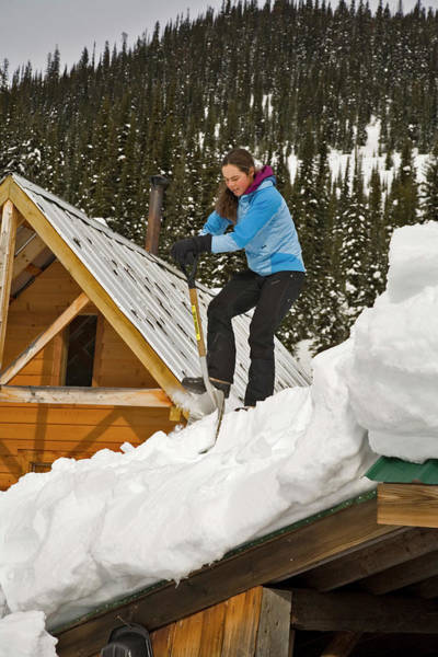 Jasmin Photograph - Woman Shoveling Snow Off Roof, British by Whit Richardson