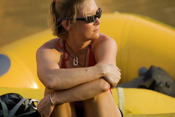 Wall Art - Photograph - Woman Sitting On A Raft by Corey Rich
