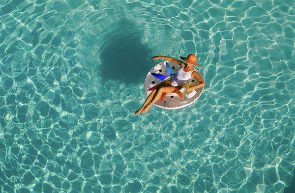 Raft Wall Art - Photograph - Woman Sitting On Float In Swimming Pool by Vintage Images