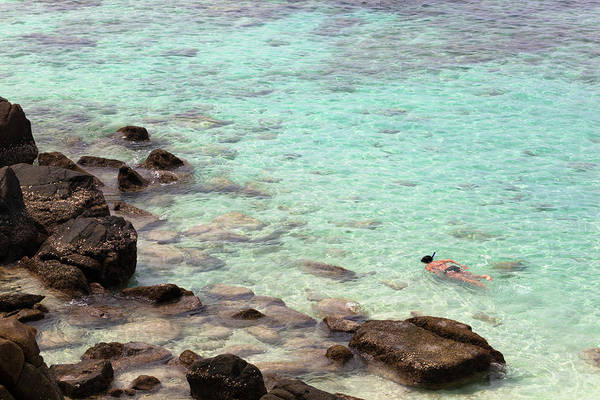 Snorkeling Photograph - Woman Snorkeling by Giorgio Fochesato
