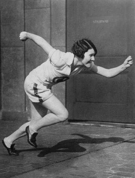 Photograph - Woman Sprinter Practicing by Underwood Archives