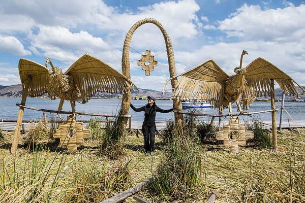 Puno Photograph - Woman Standing At Bird Sculpture by Henn Photography