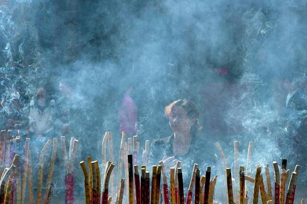 Traditional Chinese Medicine Wall Art - Photograph - Woman Standing In Front Of Incense Burner by Tony Camacho