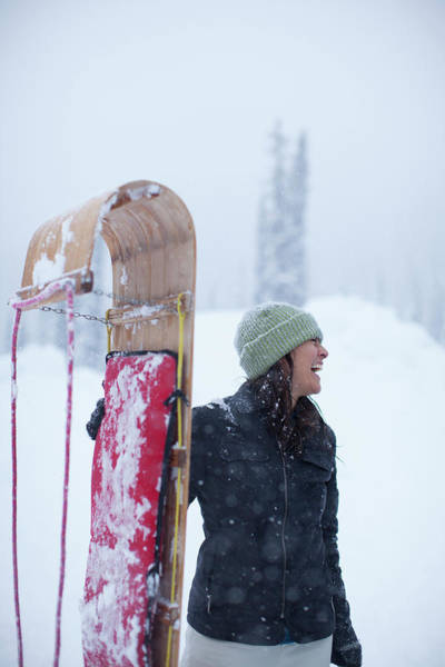 Wall Art - Photograph - Woman Standing With Toboggan Sled by Woods Wheatcroft