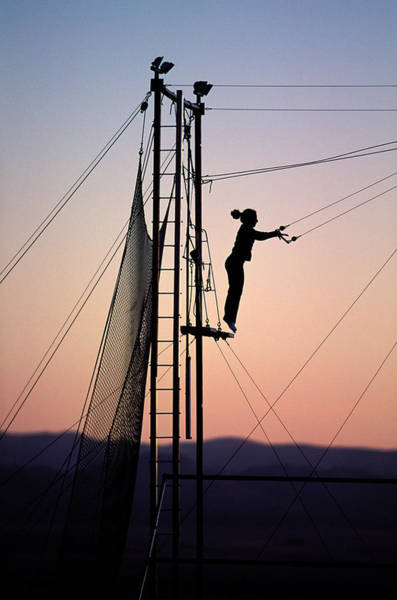 Trapeze Photograph - Woman Swinging On A Trapeze At Sunset by Corey Rich