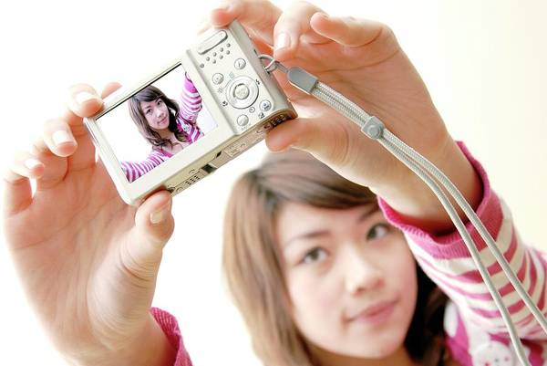 Snapping Wall Art - Photograph - Woman Taking A Photograph Of Herself by Aj Photo/science Photo Library