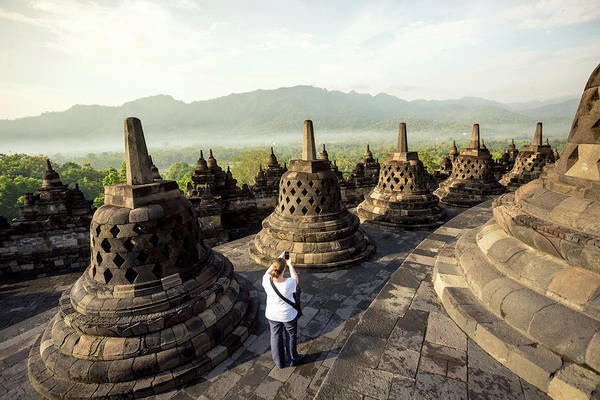 Indonesian Culture Photograph - Woman Taking Pictures Of Stupas by Konstantin Trubavin