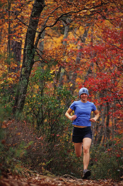 Workout Photograph - Woman Trai Lrunning In The Autumn by Rich Wheater
