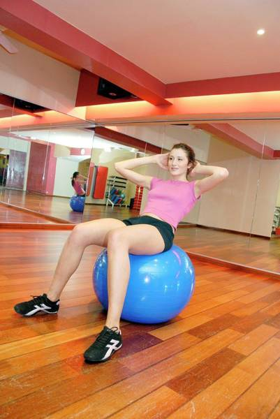 Physical Training Wall Art - Photograph - Woman Using An Exercise Ball by Aj Photo/science Photo Library