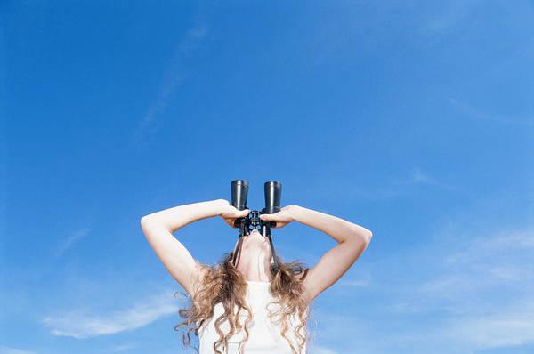 Woman Using Binocular, Looking Up, Low Angle View Art Print by David De Lossy