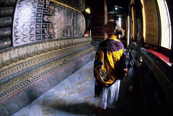 Wall Art - Photograph - Woman Walking By Reclining Buddha by Rich Wheater