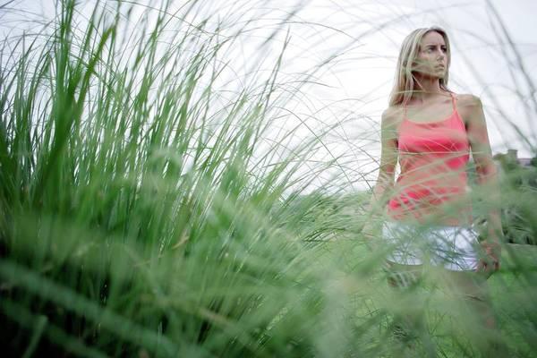 Ornamental Grass Photograph - Woman Walking by Ian Hooton/science Photo Library