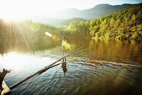 Exploration Photograph - Woman Walking On Log In Alpine  Lake by Thomas Barwick